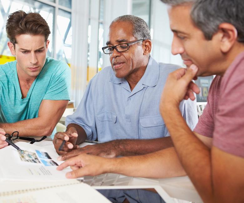 group-of-men-meeting-in-creative-office-PXEKFW4.jpg
